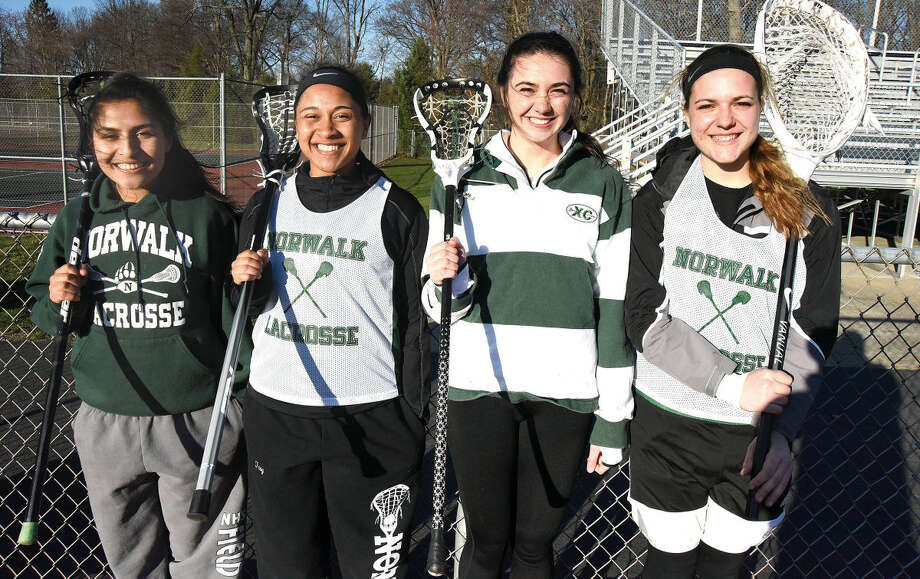 Hour photo/John Nash - Norwalk High girls lacrosse captains include, from left, Sara Meza, Arissa Troy, Brianna Fitzgerald and Maria Bellos.