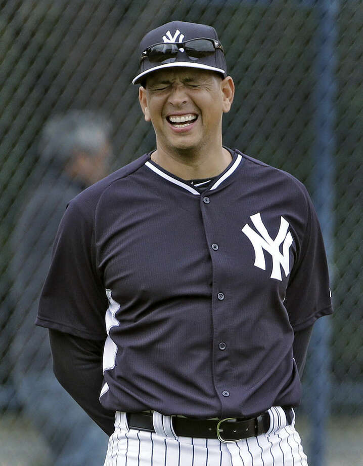 New York Yankees' Alex Rodriguez laughs while waiting for fielding practice to start during workouts Friday, Feb. 27, 2015, in Tampa, Fla. (AP Photo/Chris O'Meara)