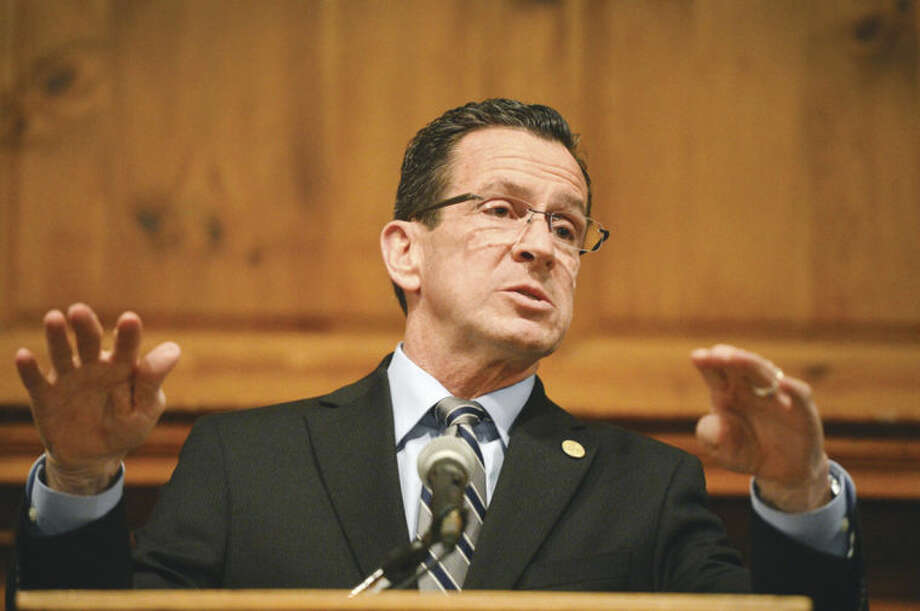 Hour Photo/Alex von Kleydorff Governor Dan Malloy answers a question about education during the first of his community forums at Norwalk City Hall on Wednesday night.