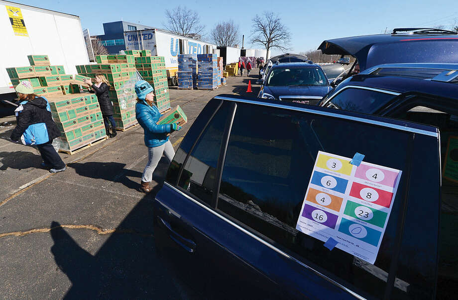 Hour photo / Erik Trautmann Girls scouts including Bridget Smith of troop 50202 help distribute nearly 2 million boxes of cookies during the annual Statewide Girl Scout Cookie Drop Saturday at Norden Place Saturday.