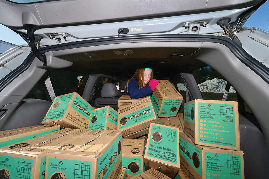 Hour photo / Erik Trautmann Girl Scouts including Katie Fitzgerald of troop 50659 help distribute nearly 2 million boxes of cookies durig the Statewide Girl Scout Cookie Drop at Norden Place in Norwalk Saturday.