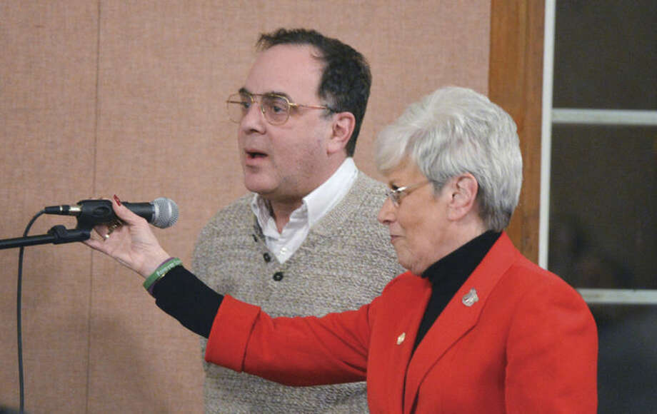 Hour Photo/Alex von Kleydorff Lt Governor Nancy Wyman helps Eric Fanwick from Wilton Ct. to the microphone to ask a question about health insurance during Governor Dan Malloys community Forum at Norwalk City hall on Wednesday night