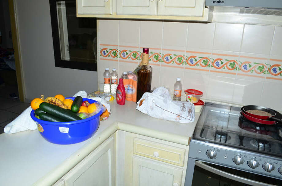 "Food and drinks sit on a kitchen countertop in the hotel room where famed drug boss Joaquin Guzman Loera ""El Chapo"" was arrested, in Mazatlan, Mexico, Saturday Feb. 22, 2014. At the moment of his arrest, Guzman was found with an unidentified woman, said one official not authorized to be quoted by name, adding that the U.S. Drug Enforcement Administration and the Marshals Service were ""heavily involved"" in the capture. No shots were fired. (AP Photo/El Debate de Mazatlan) MEXICO OUT, NO PUBLICAR EN MÉXICO"