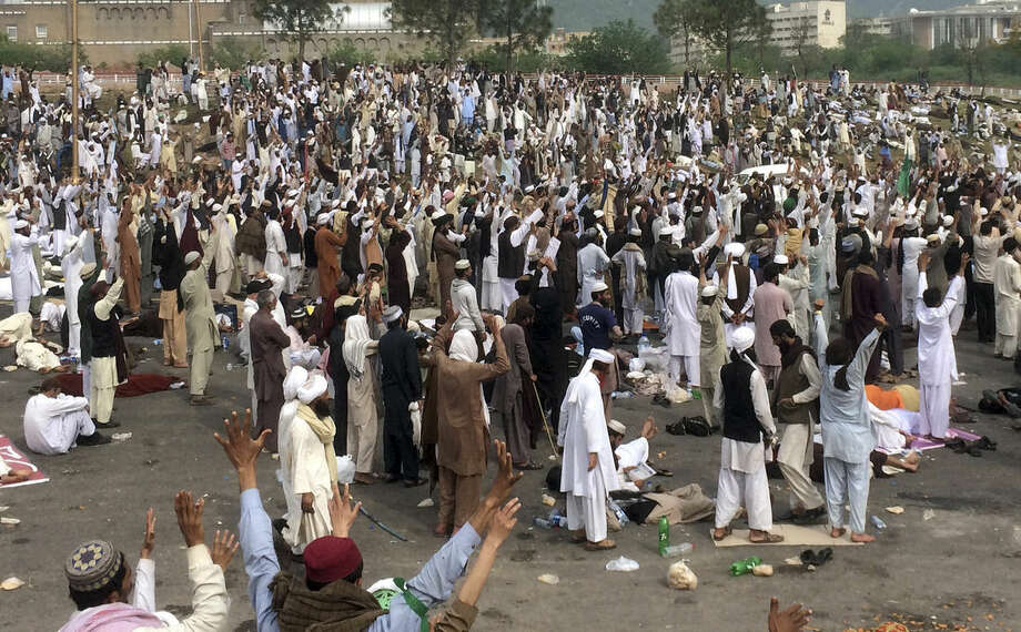 Supporters of the religious party Sunni Tehreek chant slogans during a sit-in protest near the parliament building in Islamabad, Pakistan, Monday, March 28, 2016. Thousands of demonstrators marched into the Pakistani capital to protest the hanging of Qadri, charged with murdering a secular governor. Police officer, Muhammad Nasim, said that the march of thousands people was peaceful initially, but as the crowds reached an avenue leading to parliament the protesters turned violent, smashing windows and damaging bus stations. (AP Photo/Anjum Naveed)