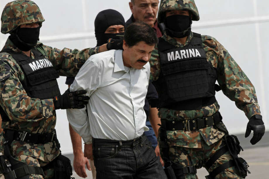 "Ap photoJoaquin ""El Chapo"" Guzman is escorted to a helicopter in handcuffs by Mexican navy marines at a navy hanger in Mexico City, Saturday."