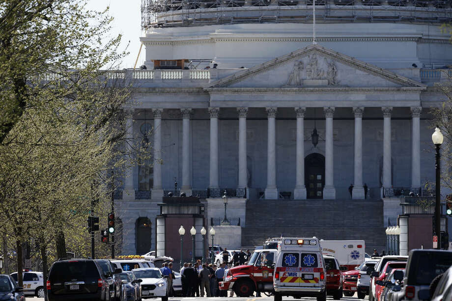 Law Enforcement and rescue vehicles are seen on Capitol Hill in Washington, Monday, March 28, 2016, after a U.S. Capitol Police officer was shot at the Capitol Visitor Center complex, and the shooter was taken into custody. (AP Photo/Alex Brandon)