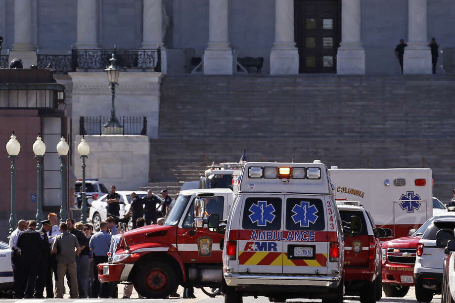 Law Enforcement and rescue vehicles are seen on Capitol Hill in Washington, Monday, March 28, 2016, after reports of gunfire at the Capitol Visitor Center complex. (AP Photo/Alex Brandon)
