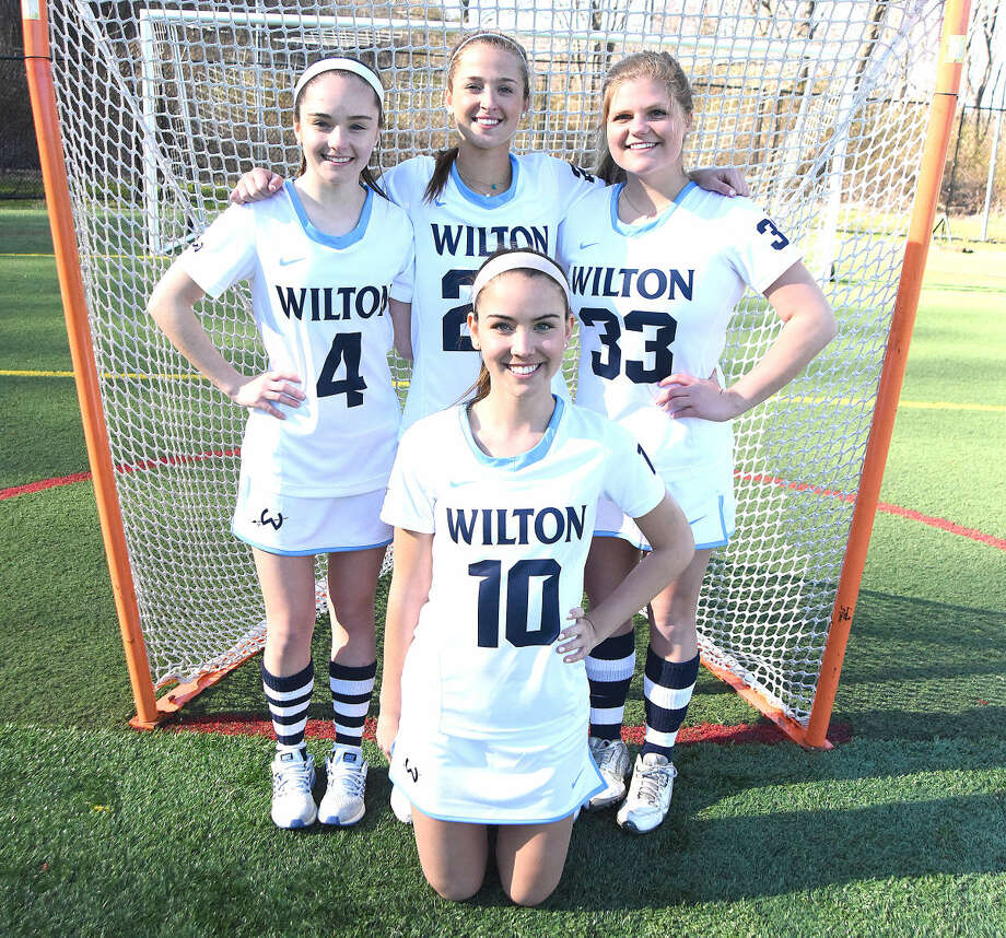 Wilton girls lacrosse captains include, Lilla Seymour, front, and back row, from left, Ella Mannix, Maddie Duffy and Campbell Gulbin.