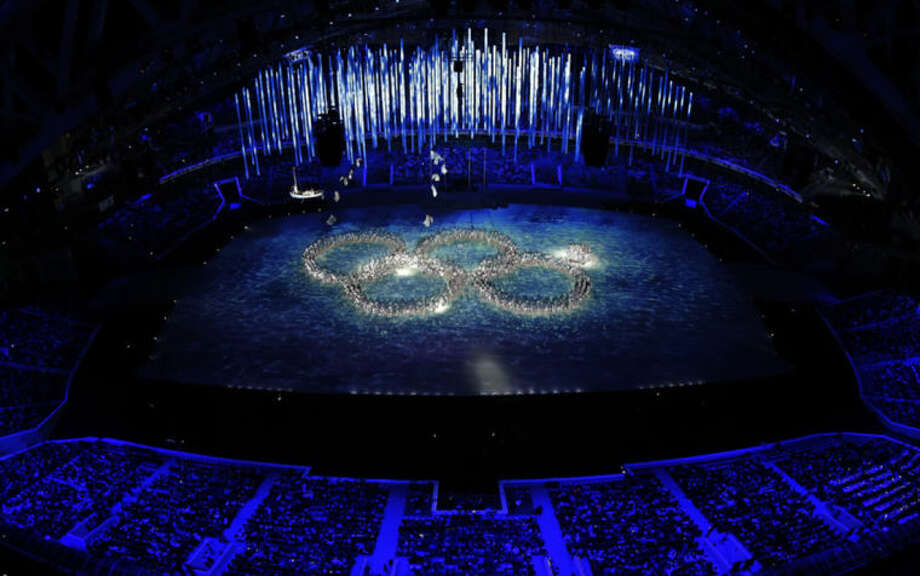 Performers recreate the ring that did not open during the opening ceremony during the closing ceremony of the 2014 Winter Olympics, Sunday, Feb. 23, 2014, in Sochi, Russia. (AP Photo/David J. Phillip )