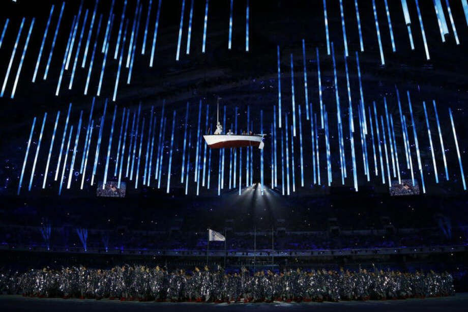 A boat is suspended in the air as performers participate in the closing ceremony of the 2014 Winter Olympics, Sunday, Feb. 23, 2014, in Sochi, Russia. (AP Photo/Darron Cummings)