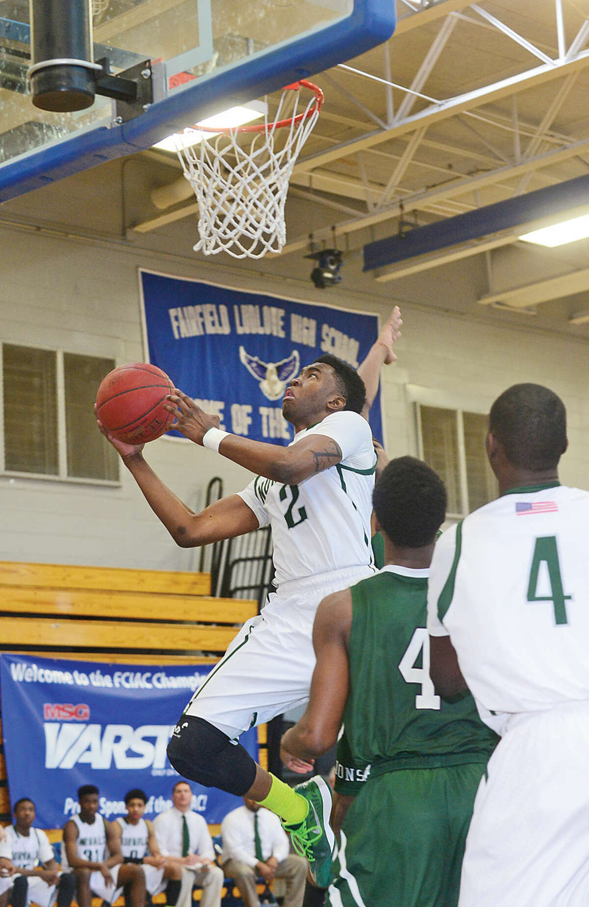 Hour photo / Erik Trautmann Norwalk takes on Bassick in their FCIAC Boys Basketball Quarterfinal Saturday at Fairfield Ludlowe High School.