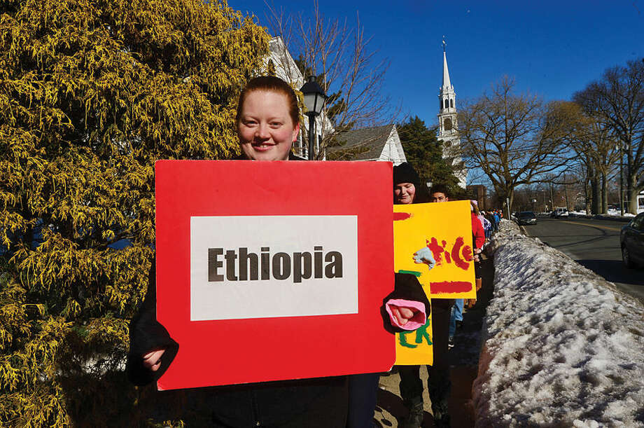 """Hour photo / Erik Trautmann Participants and volunteers gather into """"countries"""" and march to St. Philips Church on Conlon Place in Norwalk to kick-off the church's 30-Hour Famine event and raise money the for worldwide hunger."""