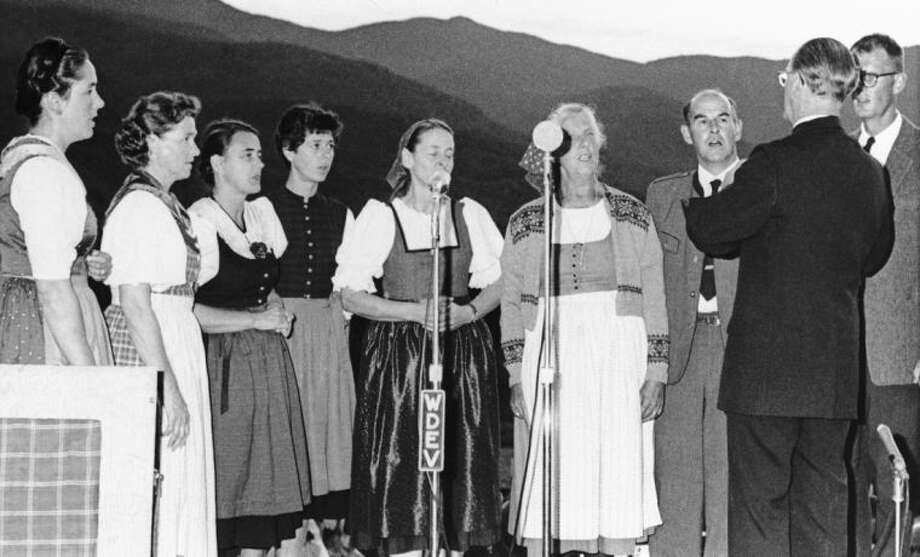 "File-This Aug. 5, 1966, file photo shows members of the Trapp family as they gave a public concert at the family lodge in Stowe, Vermont,under the direction of Msgr, Franz Wasner, their chaplain, and musical director. From left to right are: Mrs. Hugh Campbell, Walpole, Mass.; Agatha, Baltimore, Md. Maria, lay missionary in New Guinea; Rosemarie, New Haven, Conn.; Hedwig, Stowe; Mrs. Maria Augusta Trapp, mother, Stowe; Werner, Stowe, and Johannes, Stowe. The last surviving member of the famous Trapp Family Singers made famous in ""The Sound of Music"" died this week at her home in Vermont. Maria von Trapp was 99. (AP Photo/File)"