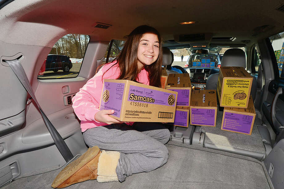 Hour photo / Erik Trautmann Girls scouts including Emma Van Riper of troop 50801 help distribute nearly 2 million boxes of cookies during the annual Statewide Girl Scout Cookie Drop Saturday at Norden Place Saturday.