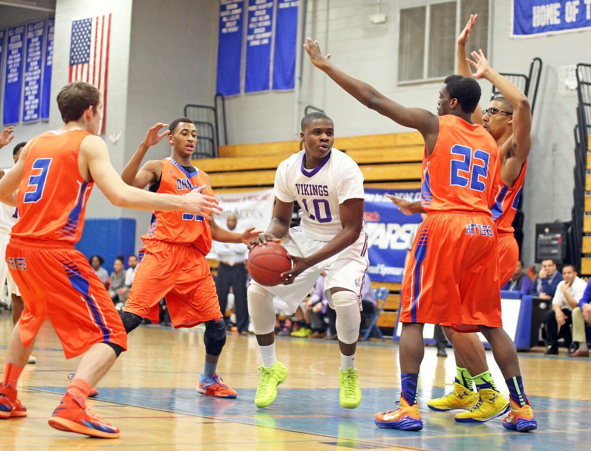 Westhill's #10, Tyrell Alexander, makes a pass during a FCIAC Quarter Finals game against Danbury at Fairfield Ludlowe High School Saturday evening. Hour Photo / Danielle Calloway