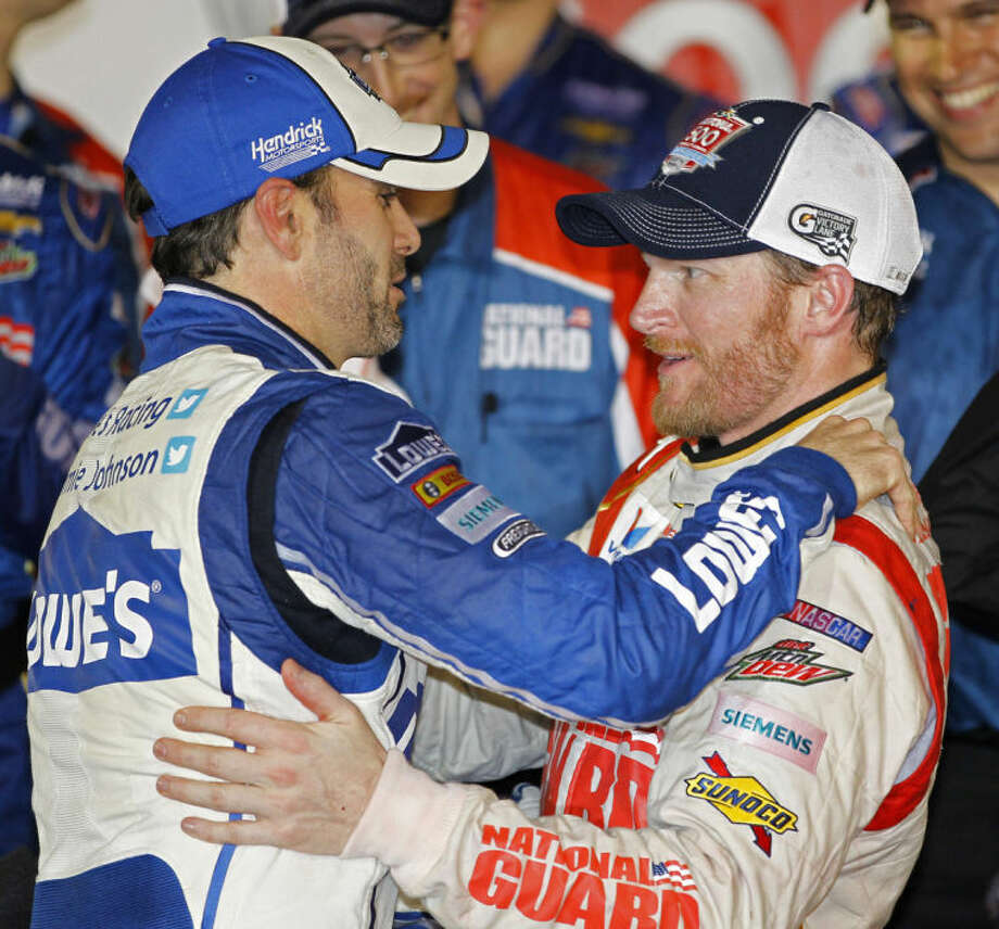 Dale Earnhardt Jr., right, celebrates in Victory Lane with teammate Jimmie Johnson, left, after winning the NASCAR Daytona 500 Sprint Cup series auto race at Daytona International Speedway in Daytona Beach, Fla., Sunday, Feb. 23, 2014. (AP Photo/Terry Renna)