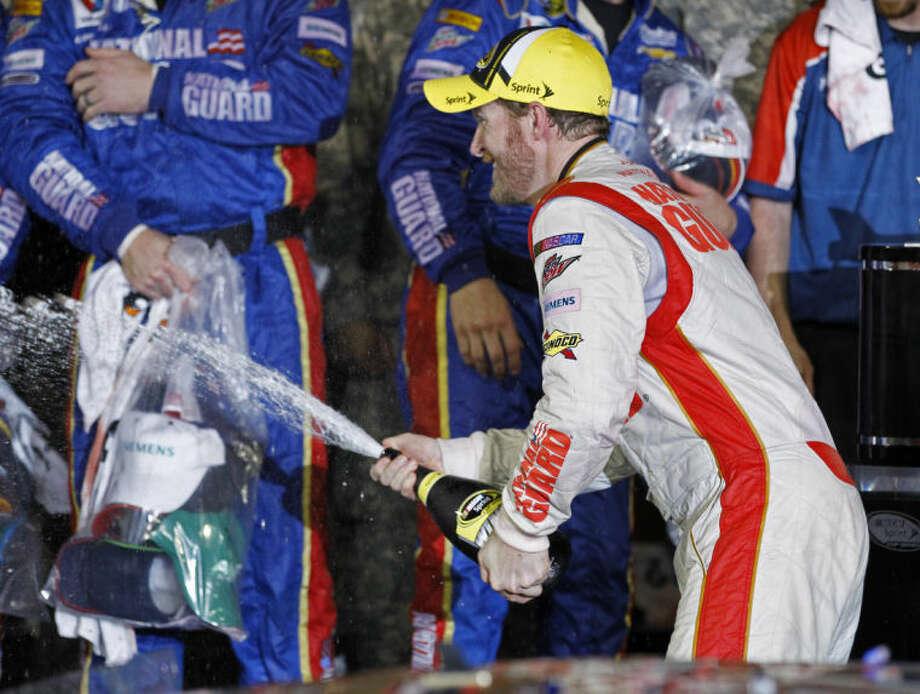 Dale Earnhardt Jr. celebrates in Victory Lane after winning the NASCAR Daytona 500 Sprint Cup series auto race at Daytona International Speedway in Daytona Beach, Fla., Sunday, Feb. 23, 2014. (AP Photo/Terry Renna)