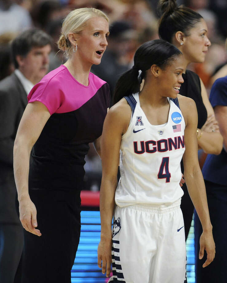 In this March 28, 2016 photo, Connecticut assistant coach Shea Ralph, left, talks with player Moriah Jefferson after UConn defeated Texas in the regional final of the women's NCAA college basketball tournament in Bridgeport, Conn. Ralph, a former UConn player and national player of the year, has been coaching with Geno Auriemma at UConn for seven seasons. (AP Photo/Jessica Hill)