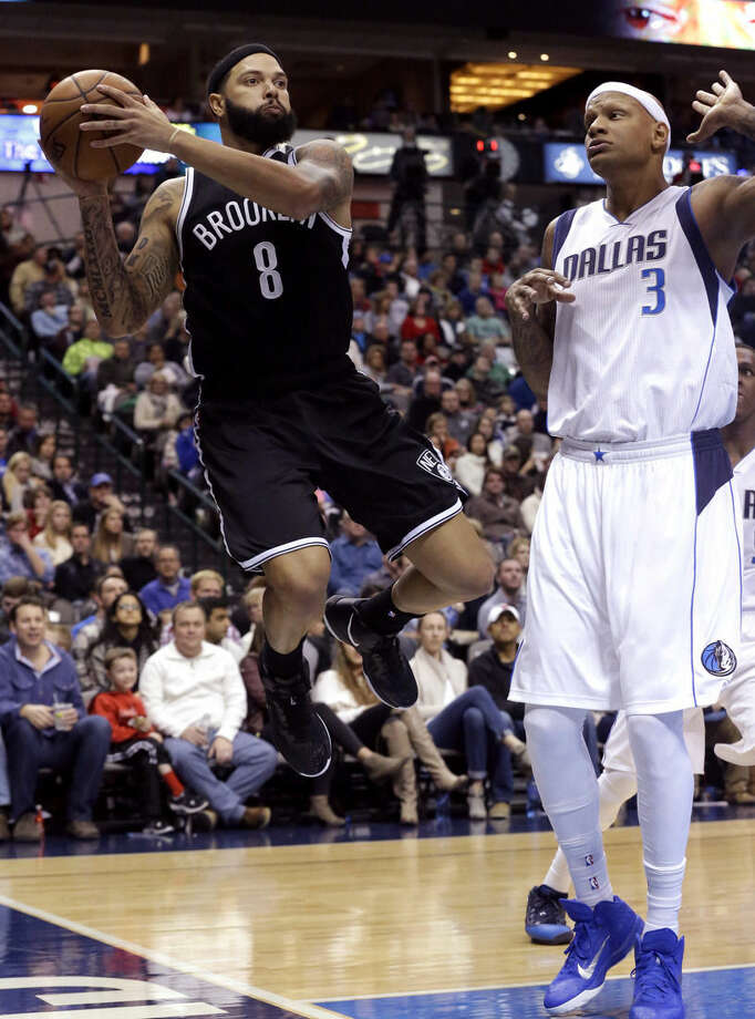 Brooklyn Nets guard Deron Williams (8) looks to pass before landing out of bounds against Dallas Mavericks forward Charlie Villanueva (3) during the first half of an NBA Basketball game Saturday, Feb. 28, 2015, in Dallas. (AP Photo/LM Otero)