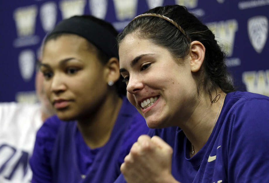 Washington's Kelsey Plum, right, talks about her team as she sits with Talia Walton during a news conference Tuesday, March 29, 2016, in Seattle. Washington plays Syracuse in a Final Four basketball game Sunday. (AP Photo/Elaine Thompson)