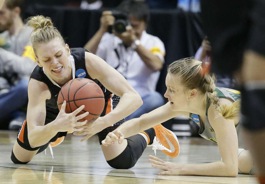 Oregon State guard Jamie Weisner, left, grabs the loose ball against Baylor guard Kristy Wallace, right, during the second half of a regional final of the women's NCAA Tournament Monday, March 28, 2016, in Dallas. Oregon State win 60-57. (AP Photo/LM Otero)