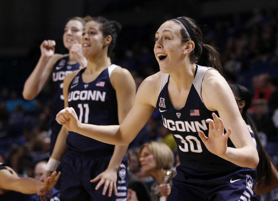 FILE - In this Jan. 27, 2016, file photo, Connecticut's Breanna Stewart celebrates her team's play during the second half of an NCAA college basketball game against Tulsa in Tulsa, Okla. Stewart has earned The Associated Press All-America honors three times, becoming just the sixth player to do so. Stewart headlined the team announced Monday, March 28, 2016, along with teammate Moriah Jefferson, Ohio State's Kelsey Mitchell, Minnesota's Rachel Banham and South Carolina's A'ja Wilson. (AP Photo/Dave Crenshaw, File)