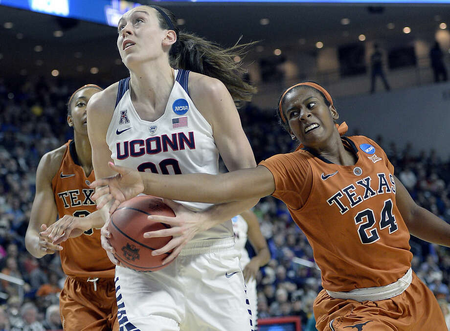 Texas' Ariel Atkins, right, tries to grab the ball from Connecticut's Breanna Stewart during the second half of a college basketball game in the regional final of the women's NCAA Tournament, Monday, March 28, 2016, in Bridgeport, Conn. (AP Photo/Jessica Hill)