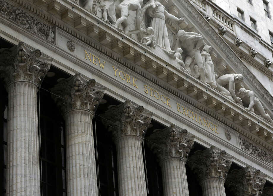 The facade of the New York Stock Exchange, Thursday, Oct. 2, 2014. European stock markets bounced back Wednesday Nov. 5, 2014 from the sell-off triggered by lower growth forecasts. Asian shares mostly fell and oil plumbed fresh lows. (AP Photo/Richard Drew)