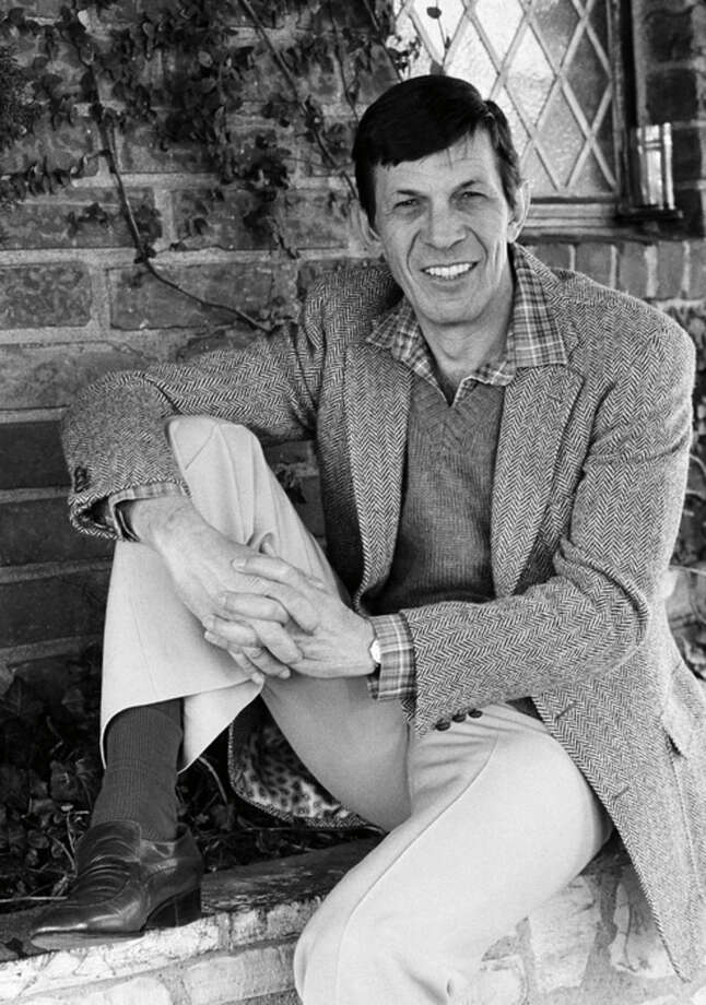 "FILE - In this Jan. 11, 1982 file photo, actor Leonard Nimoy poses for a photo in Los Angeles. Nimoy, famous for playing officer Mr. Spock in ""Star Trek"" died Friday, Feb. 27, 2015 in Los Angeles of end-stage chronic obstructive pulmonary disease. He was 83. (AP Photo/Lennox McLendon, File)"