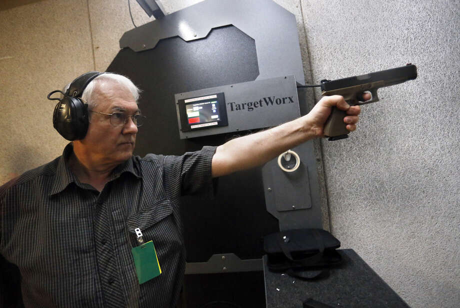 In this March 11, 2016 photo, Dr. Michael Victoroff, a physician in the Denver area whose leisure-time passion is competitive shooting, practices at a range in Centennial, Colo. Across the U.S., suicides account for nearly two-thirds of all gun deaths, with 21,334 gun deaths by suicide in 2014, according to federal data. Victoroff has become increasingly engaged in suicide prevention, and serves on a state working group seeking to raise awareness of the issue among primary-care doctors. (AP Photo/Brennan Linsley)