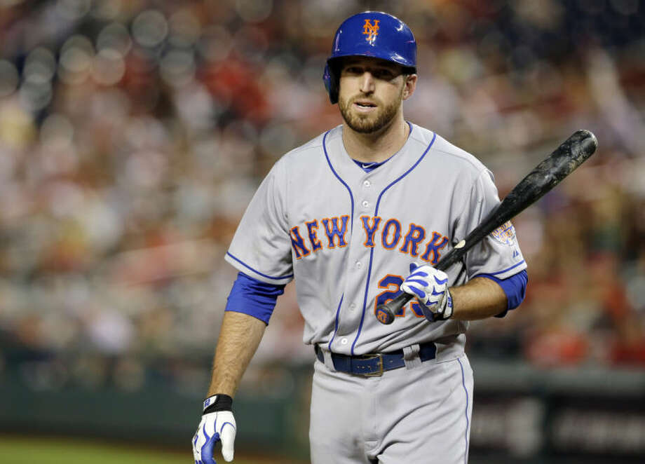 FILE - In this June 5, 2013, file photo, New York Mets first baseman Ike Davis walks away from the plate after batting during a baseball game against the Washington Nationals in Washington. Davis admits Monday, Feb. 24, 2014, he concealed a nagging oblique strain from the team last year but claims the injury wasn't a factor in his poor performance. (AP Photo/Alex Brandon, File)