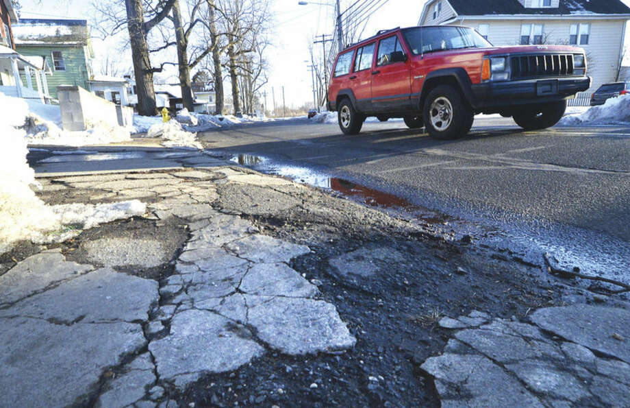 "Hour photo/Alex von KleydorffA crumbling sidewalk in Norwalk is an example of the ""terrible"" walking conditions some Norwalkers encounter."