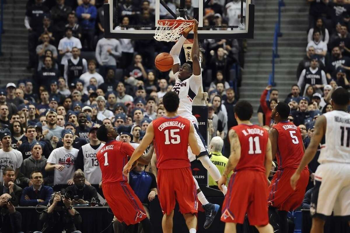 Connecticut's Amida Brimah, top center, dunks the ball as SMU defends during the first half of an NCAA college basketball game, Sunday, March 1, 2015, in Hartford, Conn. (AP Photo/Jessica Hill)