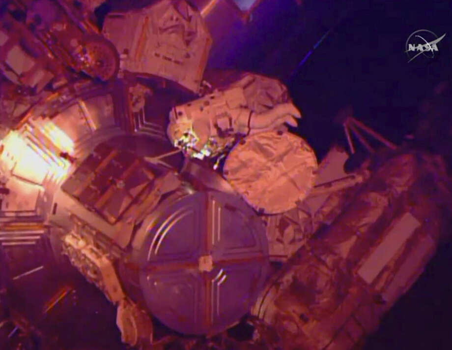In this image from NASA television astronaut Terry Virts exits the Quest airlock hatch beginning the third spacewalk outside the International Space Station early Sunday morning March 1, 2015. Terry Virts and Butch Wilmore have 400 feet of cable and two antennas to install. Once that's complete, the spacewalkers will have routed nearly 800 feet of power and data lines, all of it needed for future American crew capsules. (AP Photo/NASA-TV)