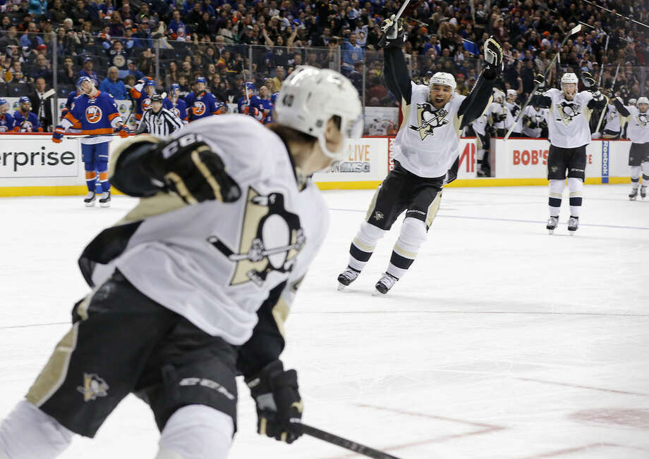 Pittsburgh Penguins defenseman Trevor Daley, center, reacts after Oskar Sundqvist, left, scored a goal against the New York Islanders during the first period of an NHL hockey game, Saturday, April 2, 2016, in New York. (AP Photo/Julie Jacobson)