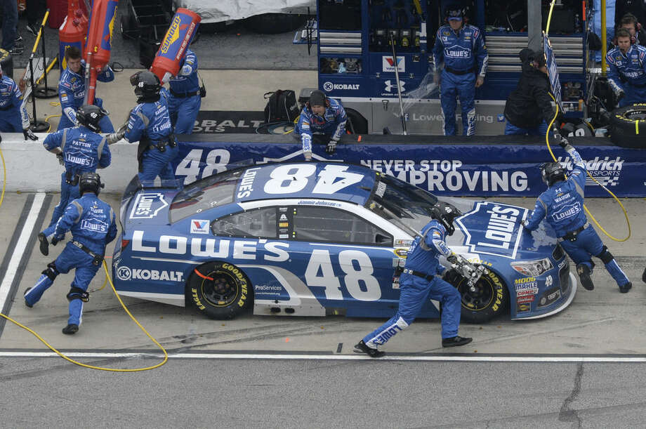 Jimmie Johnson pits during the NASCAR Sprint Cup series auto race at Atlanta Motor Speedway, Sunday, March 1, 2015, in Hampton, Ga. Johnson won the race. (AP Photo/Joe Sebo)