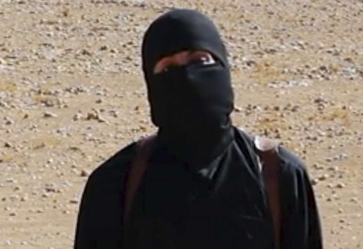 FILE - This still image from undated video released by Islamic State militants on Oct. 3, 2014, purports to show the militant known as Jihadi John. A U.S. drone strike targeted a vehicle in Syria believed to be transporting the masked Islamic State militant known as