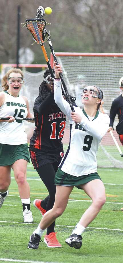 Norwalk's Grace Bradley catches a pass from a teammate against Stamford on Saturday.