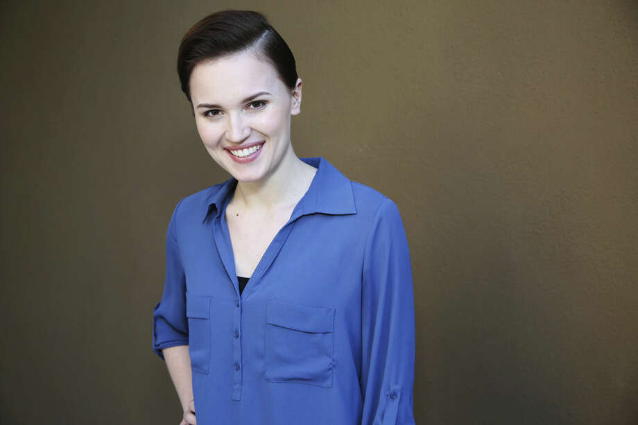 """FILE - In this Saturday, March 8, 2014, file photo, Veronica Roth, author of the book, """"Divergent,"""" poses for a portrait in Beverly Hills, Calif. Roth is set to write a new two-book series, HarperCollins Children's Books told The Associated Press on Monday, March 2, 2015. The books currently are untitled, with the first one expected in 2017. (Photo by Annie I. Bang /Invision/AP, File)"""