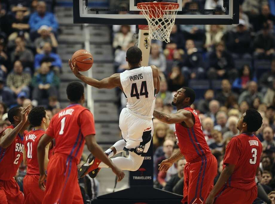 Connecticut's Rodney Purvis goes up for a basket during the second half of an NCAA college basketball game as SMU defends, Sunday,March 1, 2015, in Hartford, Conn. UConn won 81-73. (AP Photo/Jessica Hill)
