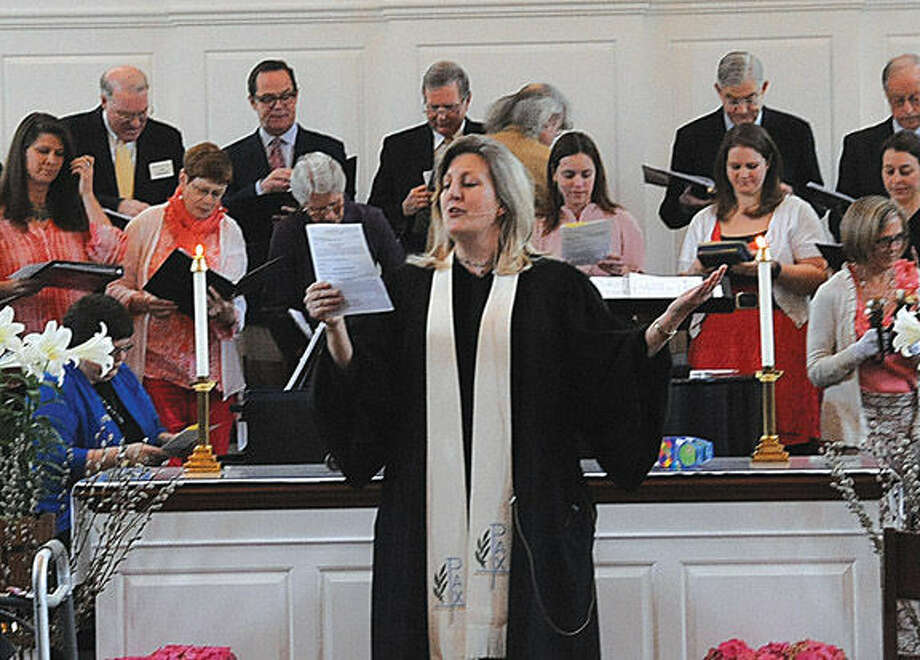 Rev. Shannon White delivers the Easter announcement at the Wilton Presbyterian Church has it's Easter service on Sunday. Photo/Matthew Vinci