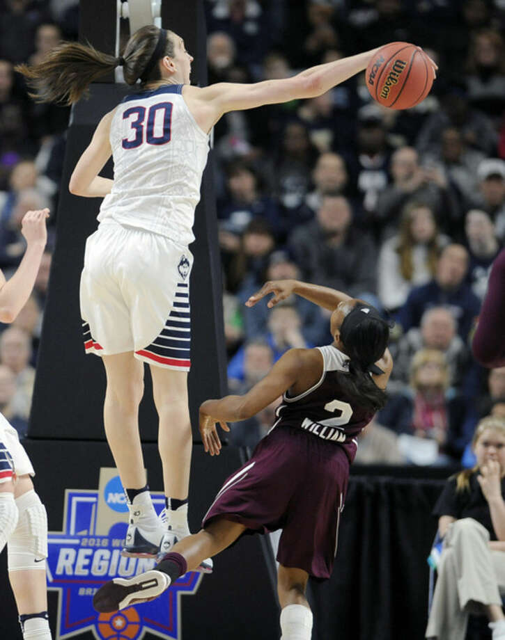Connecticut's Breanna Stewart, left, blocks a shot by Mississippi State's Morgan William during the first half of an NCAA college basketball game in the regional semifinals of the women's NCAA Tournament, Saturday, March 26, 2016, in Bridgeport, Conn. (AP Photo/Jessica Hill)