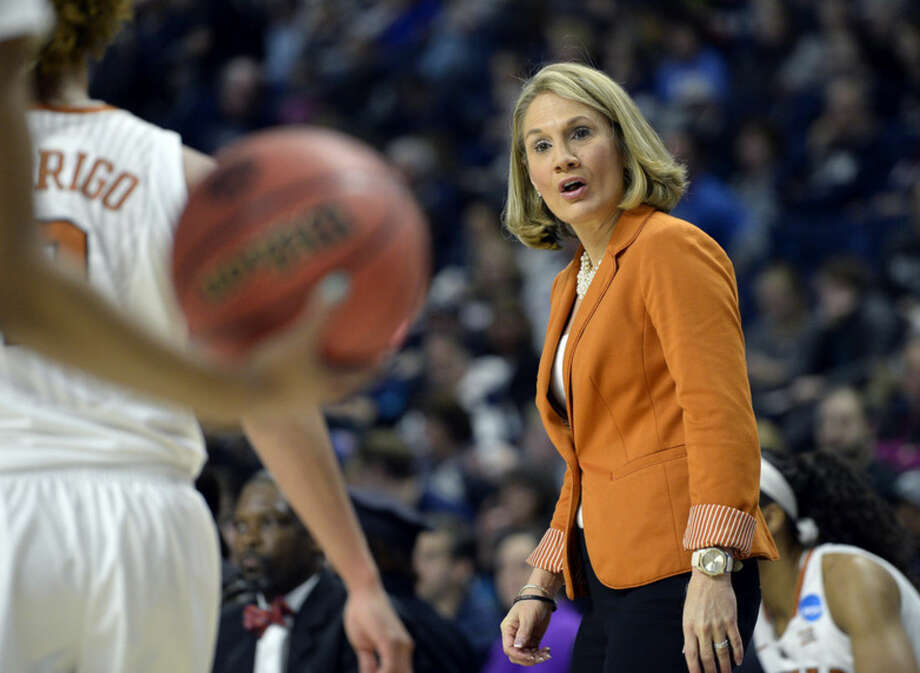Texas head coach Karen Aston gives instruction during the first half of an NCAA college basketball game against UCLA in the first half of the regional semifinals of the women's NCAA Tournament, Saturday, March 26, 2016, in Bridgeport, Conn. (AP Photo/Jessica Hill)
