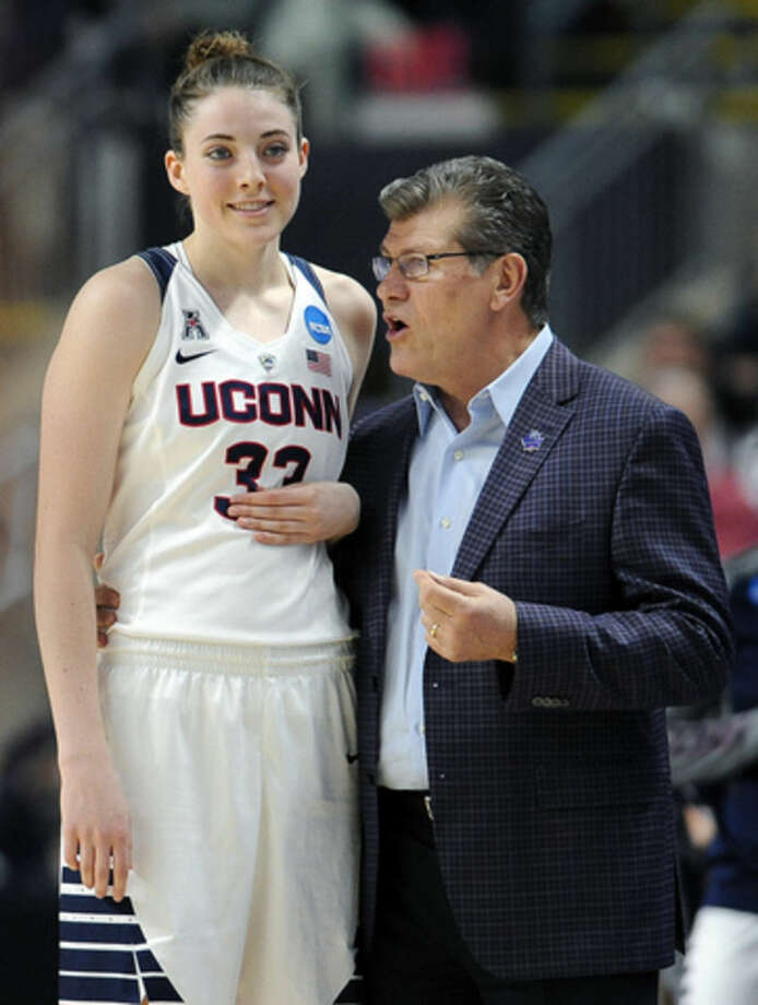 Connecticut head coach Geno Auriemma, right, instructs Katie Lou Samuelson during the first half of an NCAA college basketball game against Mississippi State in the regional semifinals of the women's NCAA Tournament, Saturday, March 26, 2016, in Bridgeport, Conn. (AP Photo/Jessica Hill)