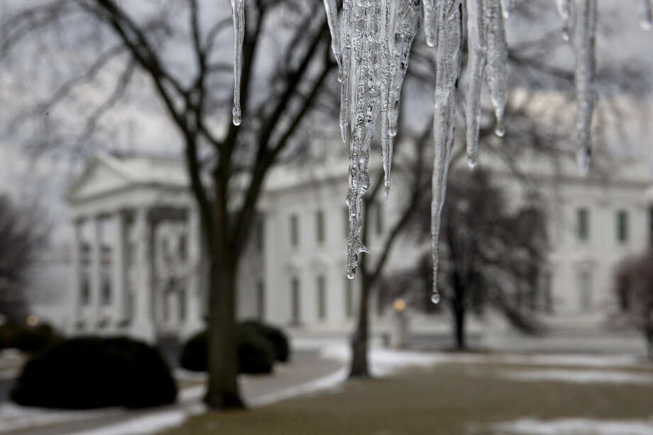 Icicles drip after an ice storm by the White House in Washington, Monday, March 2, 2015. The National Weather Service is warning of icy conditions and dense fog in the mid-Atlantic region on Monday morning after a blast of snow, sleet, ice and freezing rain on Sunday. (AP Photo/Jacquelyn Martin)