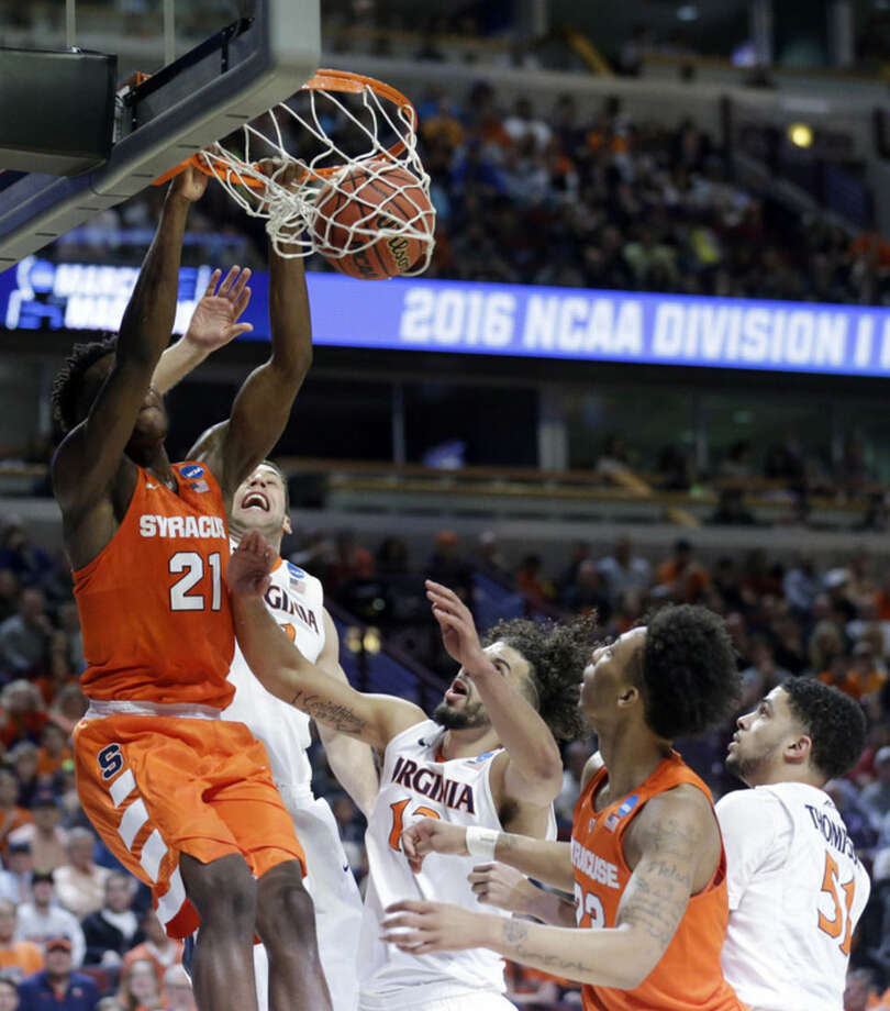 Syracuse's Tyler Roberson (21) dunks during the first half of a college basketball game against Virginia in the regional finals of the NCAA Tournament, Sunday, March 27, 2016, in Chicago. (AP Photo/Nam Y. Huh)