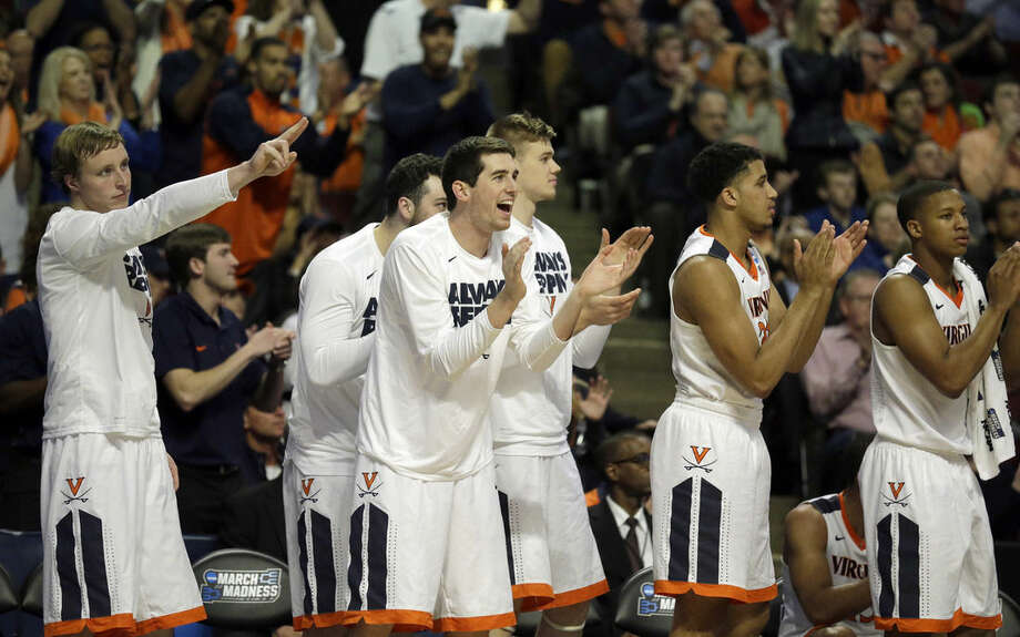 Players on Virginia bench react to a play during the first half of a college basketball game against Syracuse in the regional finals of the NCAA Tournament, Sunday, March 27, 2016, in Chicago. (AP Photo/Nam Y. Huh)