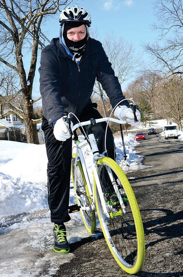 Hour photo / Erik Trautmann Norwalk resident, Rob Dabb, training for 40-mile bike ride for charity.