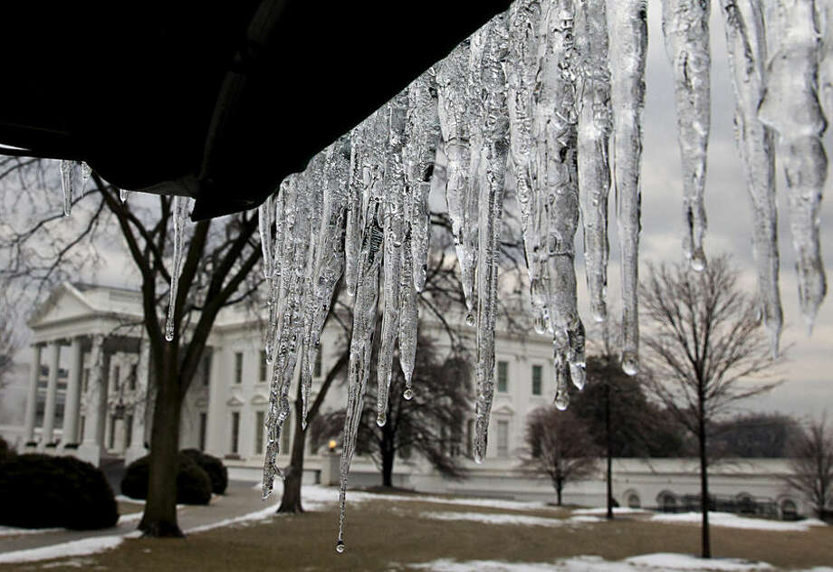 Icicles hanging from a tarp at the White House begin to melt after an ice storm in Washington, Monday, March 2, 2015. (AP Photo/Jacquelyn Martin)