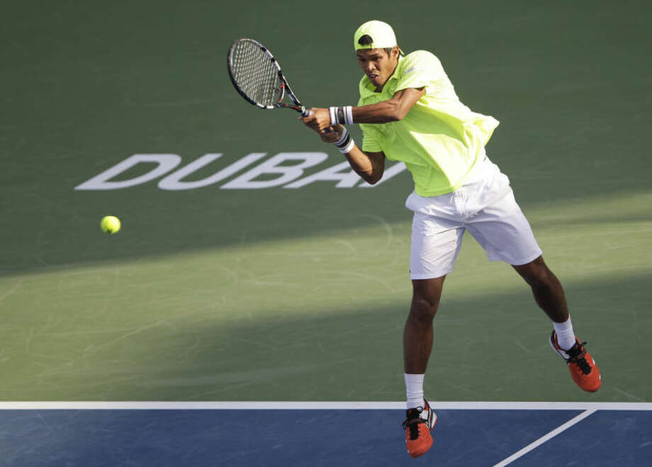 Somdev Devvarman of India returns the ball to Juan Martin Del Potro of Argentina during the second round of the Dubai Duty Free Tennis Championships in Dubai, United Arab Emirates, Tuesday, Feb. 25, 2014. (AP Photo/Kamran Jebreili)